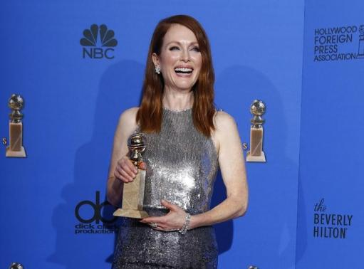 "Julianne Moore poses with her award for Best Actress in a Motion Picture, Drama for her role in ""Still Alice backstage"