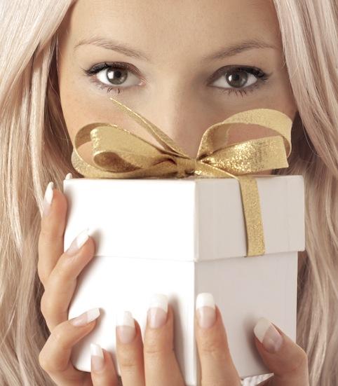 bigstock_Woman_And_Gift_4000625