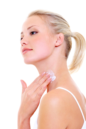 woman applying moisturizer cream on her neck