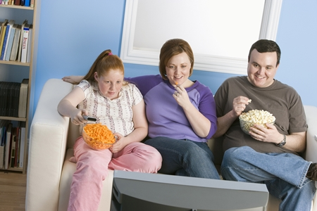 bigstock-Family-Watching-Television-36470911